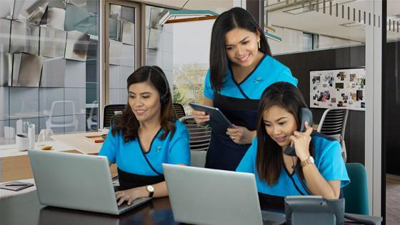 Three female virtual assistants answering phone calls